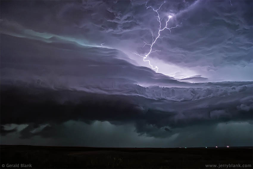 #01907 - Lightning illuminates approaching storm clouds, north of Williston, North Dakota - photo by Jerry Blank