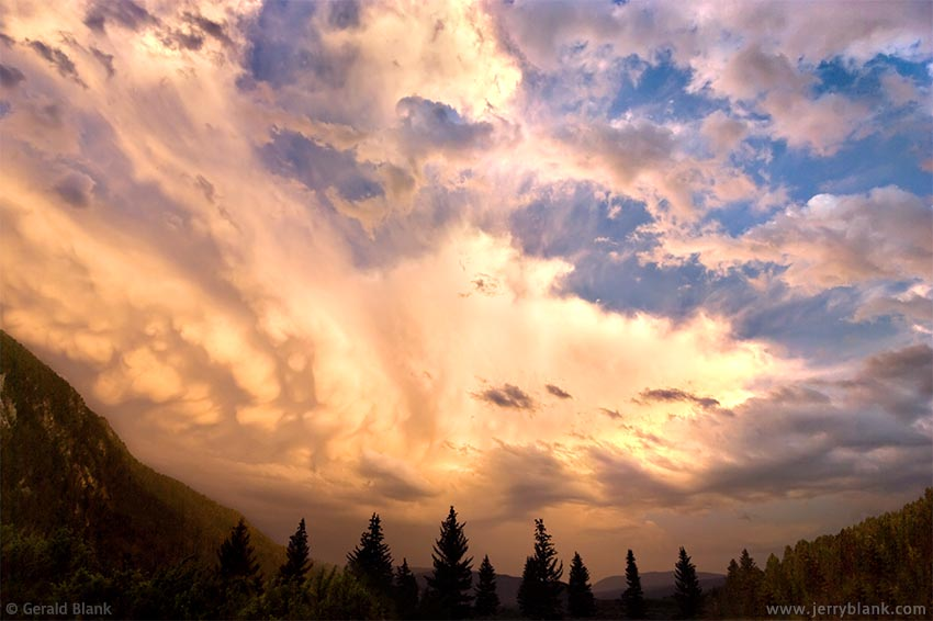 #06085 - Storm clouds dissipating over the Gallatin Canyon, near Soldier's Chapel, Big Sky, Montana - photo by Jerry Blank