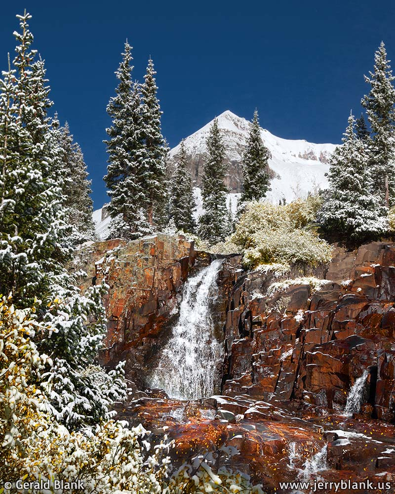 #06612 - Fresh snow covers autumn foliage around a waterfall on Sneffels Creek, in Yankee Boy Basin, Colorado, with Cirque Mountain in the background - photo by Jerry Blank