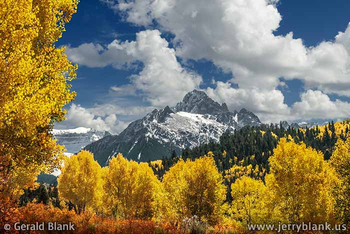 #06814 - Autumn foliage along Ouray County Road 7 frames Mount Sneffels, the highest peak in the Sneffels Range of Colorado's San Juan Mountains - photo by Jerry Blank