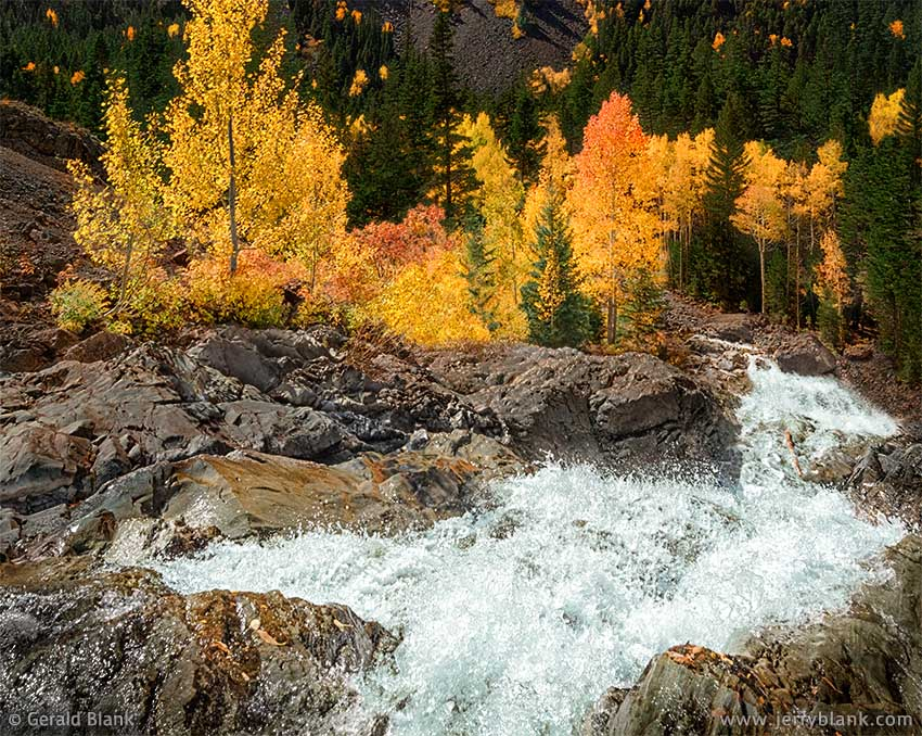 #07133 - The Uncompahgre River splashes down a colorful canyon as it flows toward Ouray, Colorado - photo by Jerry Blank