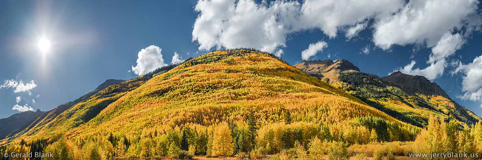 #43766 - An amazing panorama of autumn color on the foothills of Hayden Mountain in Colorado, as seen from US Hwy. 550 south of Ouray - photo by Jerry Blank