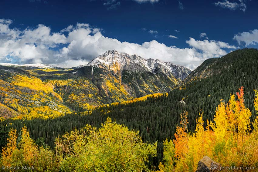 #52266 - The Twilight Peaks in the San Juan Mountains are surrounded by vivid autumn aspen color in this view from Coal Bank Pass on US Hwy. 550 in Colorado - photo by Jerry Blank